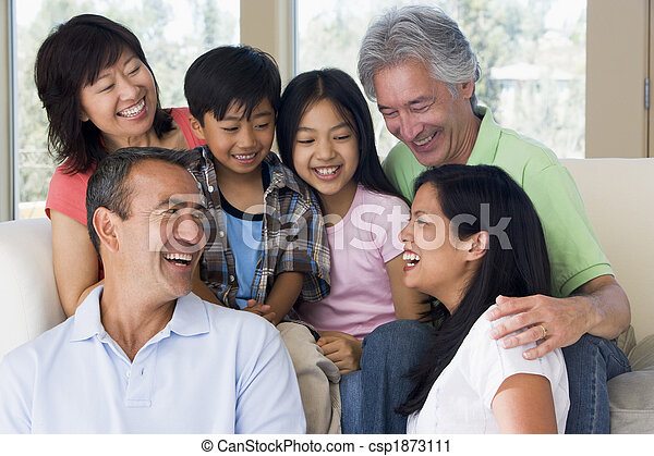 Extended family in living room smiling - csp1873111