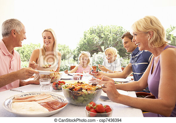 Extended family, parents, grandparents and children, eating outdoors - csp7436394
