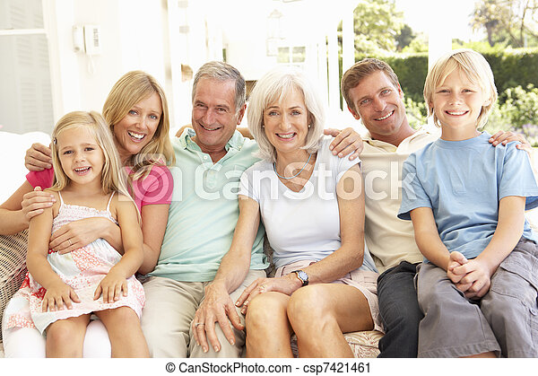 Extended Family Relaxing Together On Sofa - csp7421461