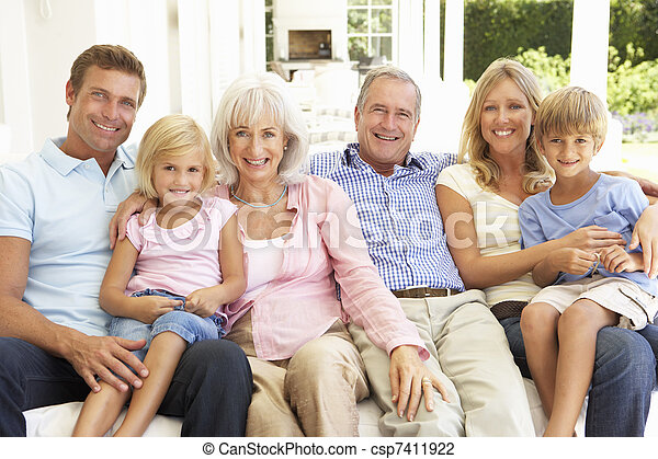 Extended Family Relaxing Together On Sofa - csp7411922