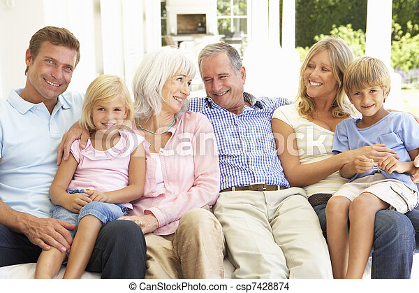 Extended Family Relaxing Together On Sofa - csp7428874