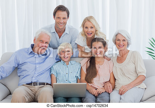Extended family sitting on couch - csp14702634
