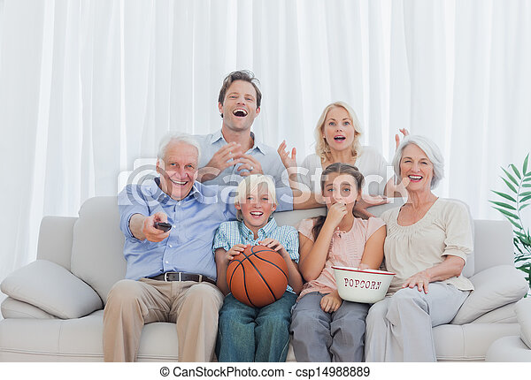Extended family watching the television - csp14988889