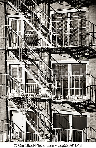 Exterior Of A Building With Old Fire Escape In New York City   Csp52091643