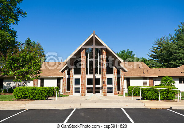 Exterior Of Modern Church With Large Cross Outside A