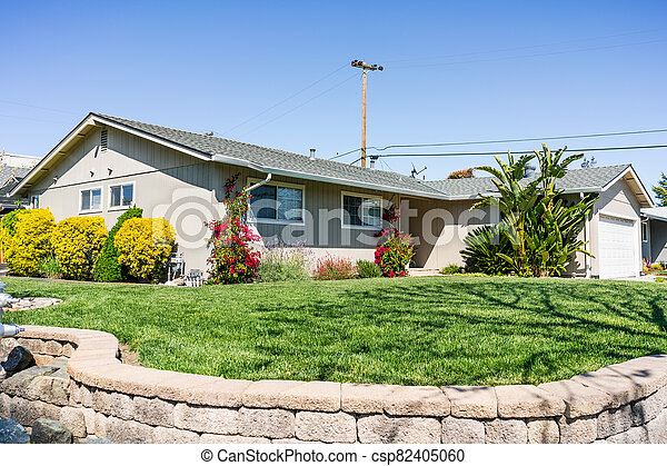 Exterior view of single-family detached home on a corner lot in a residential neighborhood; South San Francisco Bay Area, California - csp82405060
