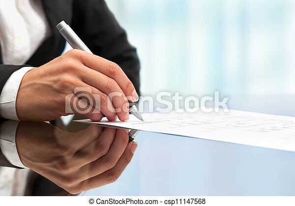 Extreme close up of female hand signing document. - csp11147568