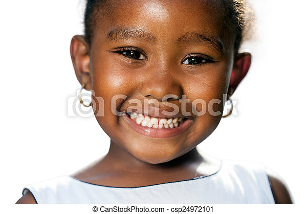 Extreme close up of small african girl showing teeth.T - csp24972101