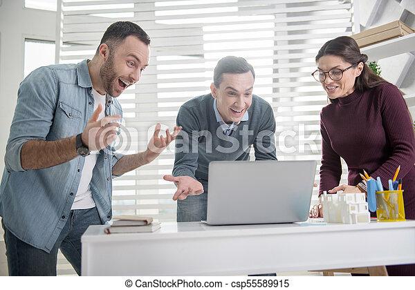 Exuberant colleagues having good news - csp55589915