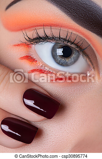 Eye makeup and manicure. - csp30895774