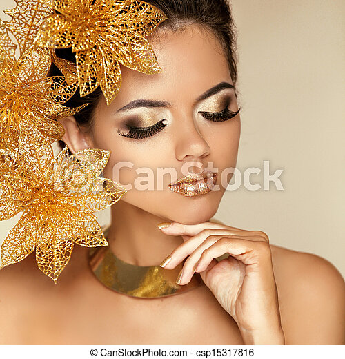 Eye Makeup. Beautiful Girl With Golden Flowers. Beauty Model Woman Face. Perfect Skin. Professional Make-up. Fashion Art Photo - csp15317816