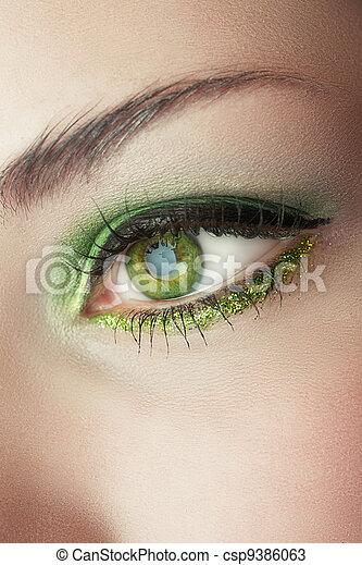 2eb9e7ac29e Eye of woman with green make-up. Macro shot of woman's eye with ...