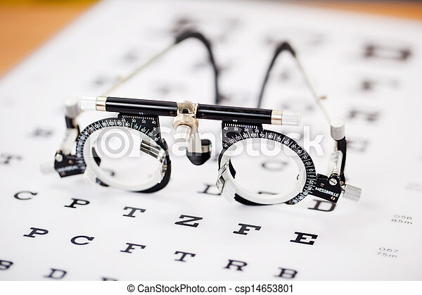 Eye Test Glasses On Snellen Chart - csp14653801