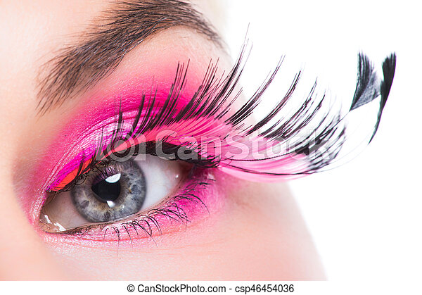e1bbad4ca39 Eye with feather false eyelashes. Macro eye of a woman with pink ...
