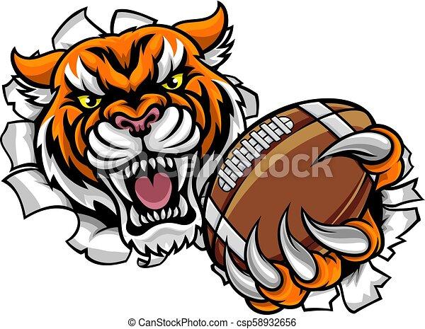 Bola de fútbol americano tigre rompiendo fondo - csp58932656