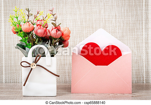 Fabric red heart shape in pink envelupe. - csp65888140