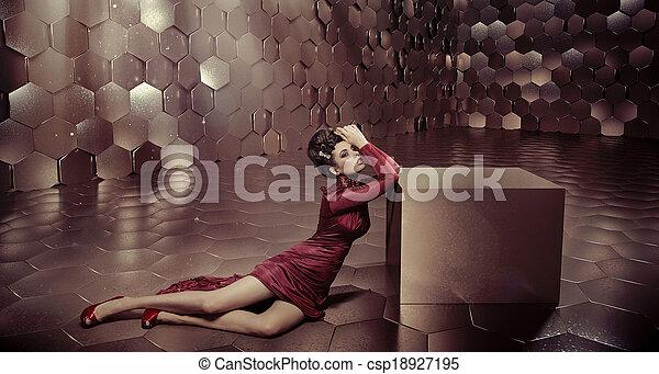 Fabulous woman in shiny golden room - csp18927195