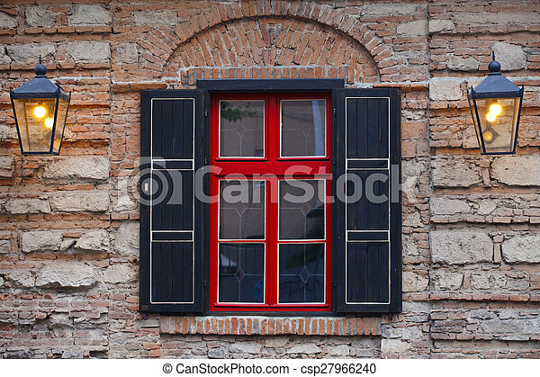 facade of the building ,  window a red- black - csp27966240