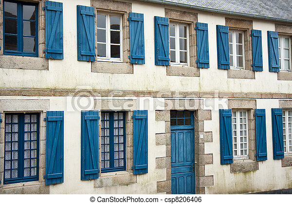 Facade of traditional breton houses with blue shutters in france - csp8206406
