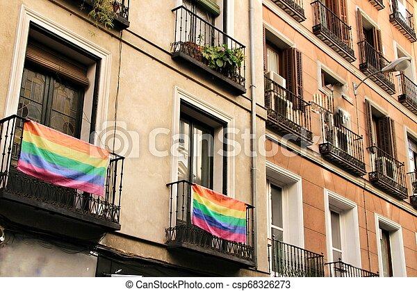 Facade with gay pride flag in Madrid - csp68326273