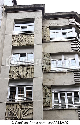 Facades of buildings with carved stone - csp32442407