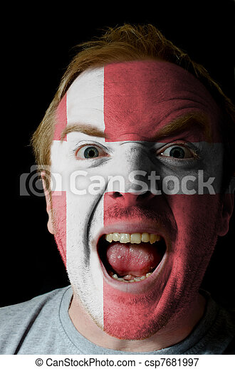 Face of crazy angry man painted in colors of denmark flag - csp7681997