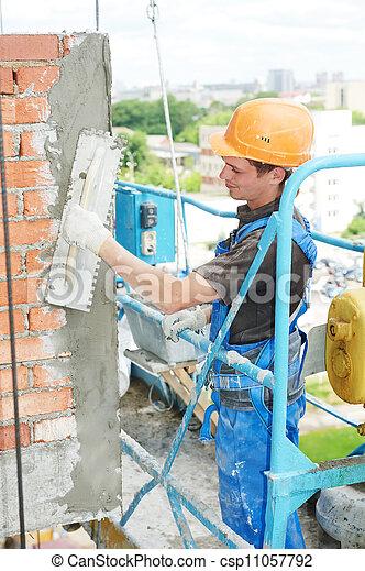 Constructor de edificios en el trabajo - csp11057792