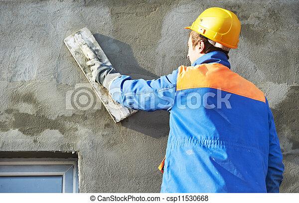 Un yesero de fachada en el trabajo - csp11530668