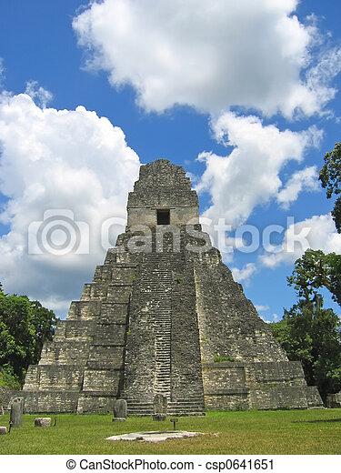 Facing to the main building of old maya ruins in the jungle, Tikal, Guatemala - csp0641651