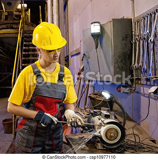 Factory female worker sharpening tools 