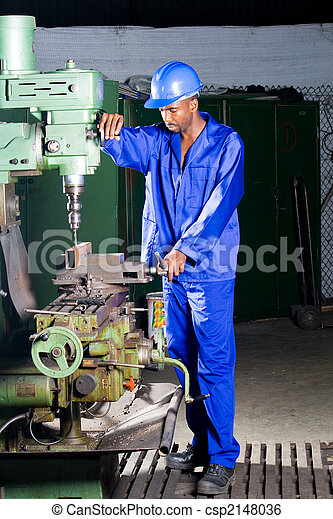 Factory mechanic at work. African mechanic working at the... stock ...