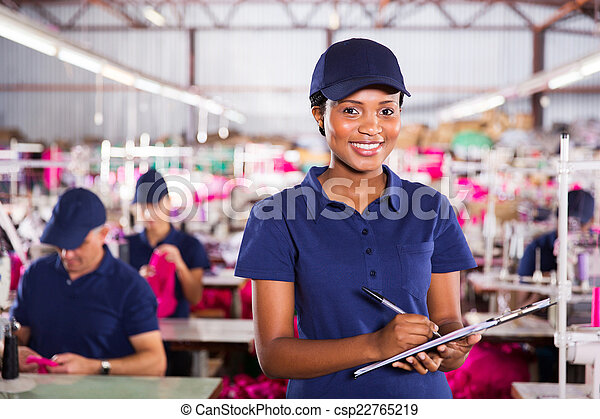 factory quality controller holding a clipboard - csp22765219
