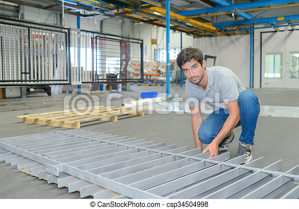 Factory worker manufacturing metal railing - csp34504998