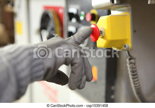 Factory worker pushing a button - csp10391458