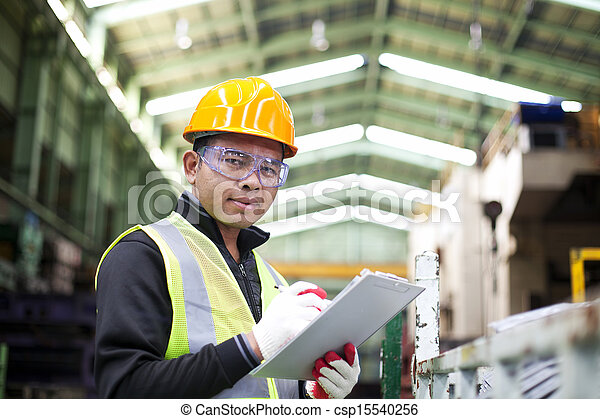 Factory worker with clipboard on the hand - csp15540256