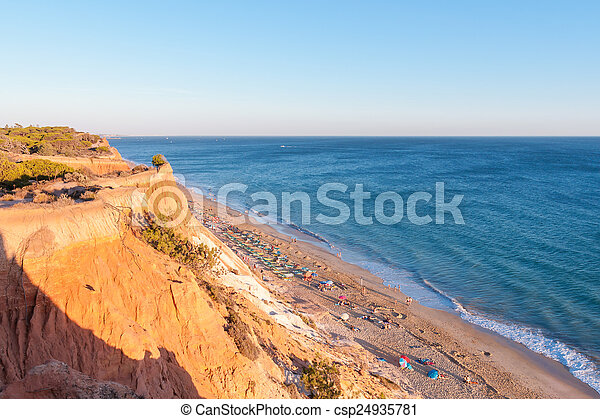 Falesia Beach seen from the cliff at sunset - csp24935781