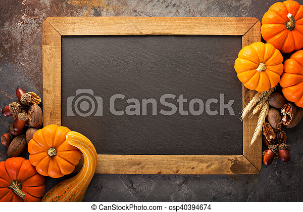 Fall chalkboard frame with pumpkins - csp40394674