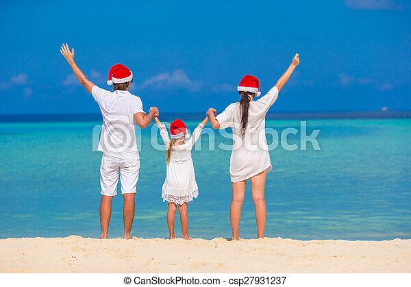 famille, chapeaux, trois, santa, plage, heureux - csp27931237