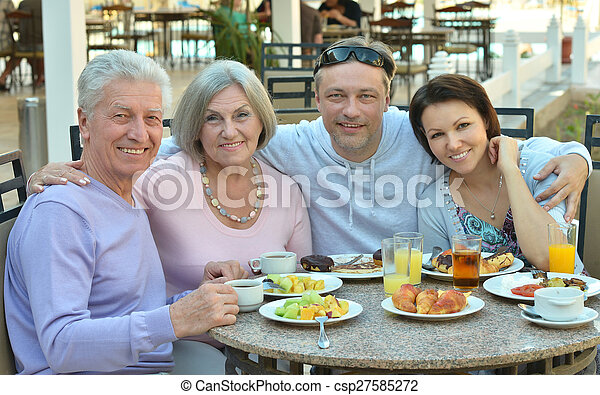Family at breakfast on resort - csp27585272