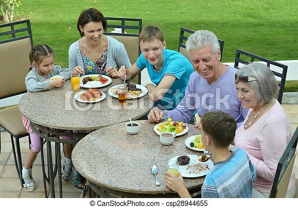 Family at breakfast on  resort - csp28944655