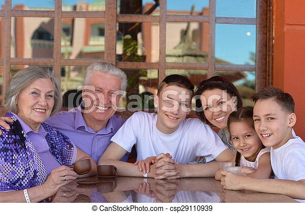 Family at breakfast on  resort - csp29110939