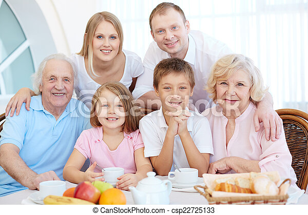Family at dinner table - csp22725133