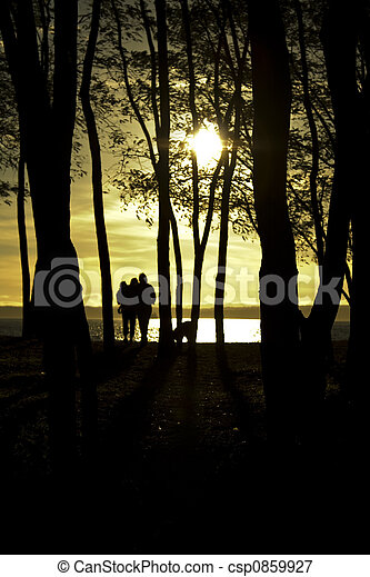 Family at sunset - csp0859927