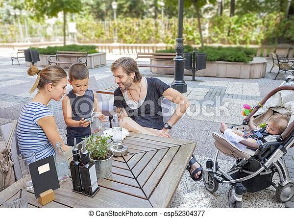 Family Cafe Outdoors Bonding Young - csp52304377