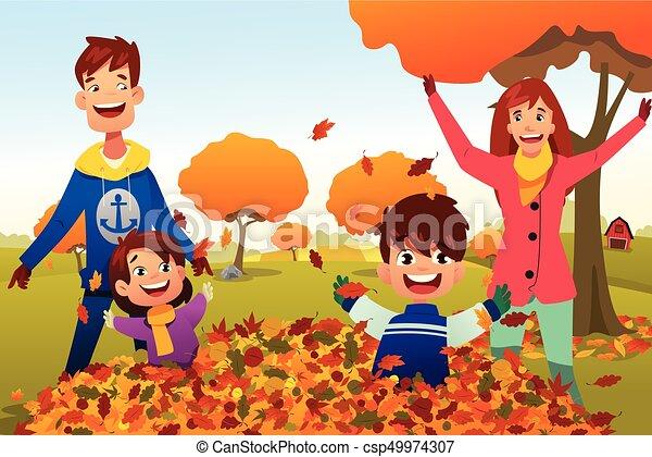 Family Celebrates Autumn Season Outdoors - csp49974307