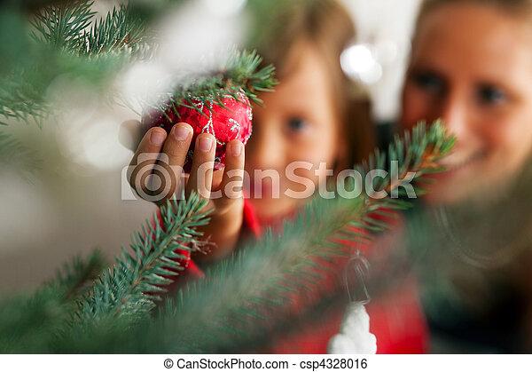 Family decorating Christmas tree - csp4328016