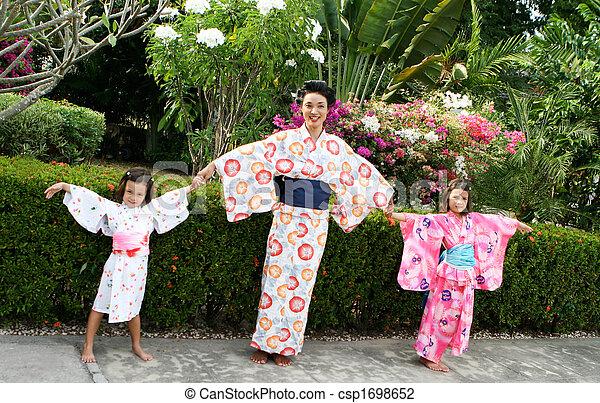 Family dressed in kimono. - csp1698652