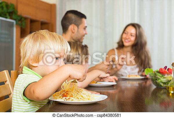 Family eating spaghetti - csp84380581