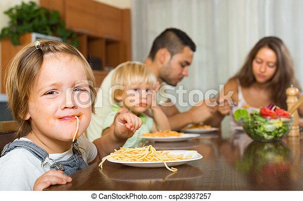 Family eating spaghetti - csp23937257
