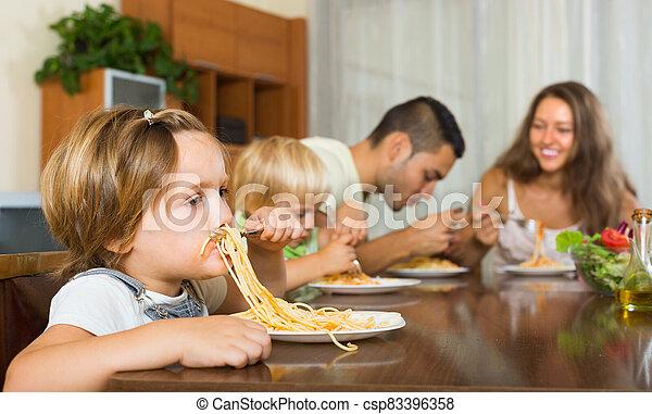 Family eating spaghetti - csp83396358